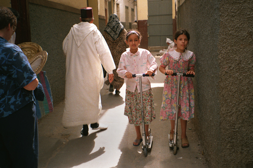 Girls with scooters in Morocco.